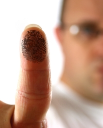 Man showing a finger with ink to get finger print